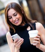 a girl with a coffe and a phone
